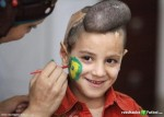 artista-pinta-imagen-jordania-bandera-nacional-brasil-cara-nino-iraqui-amman-rf_163702
